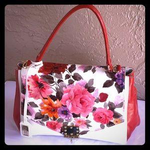 Badgley Mischka top handle handbag.